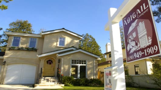 A real estate sign is posted in front of this four bedroom home in Los Altos, Calif., Wednesday, Jan. 19, 2005, that is b