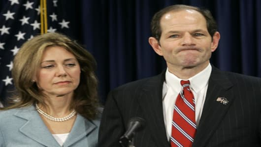 New York State Gov. Eliot Spitzer is joined by his wife Silda as he makes a statement to reporters during a news conference Monday, March 10, 2008 in New York. Spitzer has apologized to his family and the public, but did not elaborate on a bombshell report that he was involved in a prostitution ring. (AP Photo/Mary Altaffer)