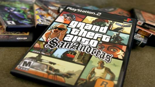 A copy of the hot selling video game, Grand Theft Auto-San Andreas, is shown with other video games at the home of Coleman Garrett in Palo Alto, Calif., Wednesday, July 20, 2005. The video game industry bowed to pressure from politicians Wednesday and changed the rating for the sex-infused game Grand Theft Auto-San Andreas. The company says it's working on a version of the game with enhanced security to prevent modifications that allow access to sexual content. Rockstar Games says it's stopped m