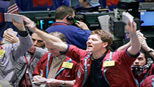 Traders buy and sell crude oil futures contracts at the New York Mercantile Exchange.