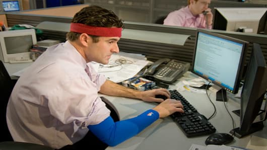 Darren Rovell wearing the shooting sleeve and headband.
