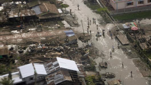 A village damaged by Cyclone Nargis is seen Thursday, May 22, 2008 in an aerial view over the Irrawaddy delta, Myanmar from the helicopter carrying United Nations Secretary General Ban Ki-Moon. (AP Photo/United Nations, Evan Schneider)