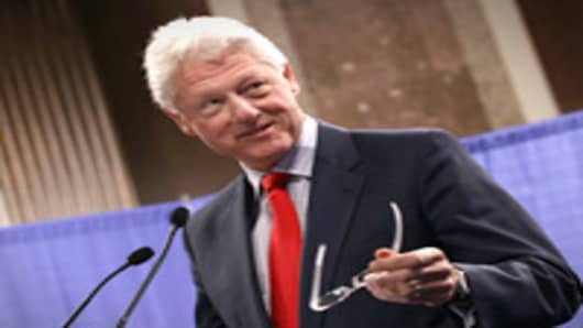 Former U.S. President Bill Clinton seen speaking during the inaugural Rural Summit in Washington, DC