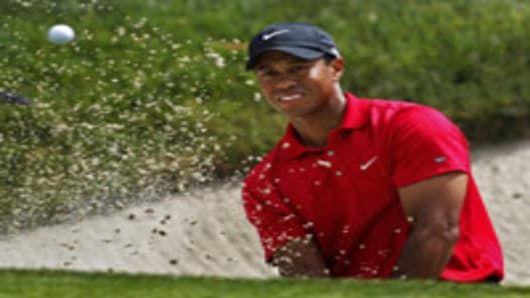 Tiger Woods hits out of a bunker on the eighth green during a playoff round at the US Open golf tournament, Torrey Pines Golf, San Diego, California.