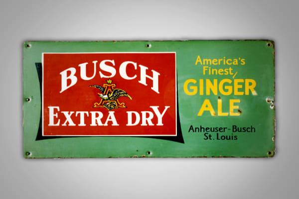 This particular metal sign is for Busch Ginger Ale, one of 26 different products that Anheuser-Busch created during prohibition. Collectors value this item at $ 250 to $300 dollars.