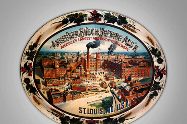 "Used to serve beer to bar patrons, this tray shows the brewery buildings of the Anheuser-Busch Brewery in St. Louis. Originating in the 1890s, decorated trays were popular through 1917. This tray is sometimes referred to as the ""Factory Scene Tray."" Collectors value this item at $1,200 to $1,500."