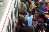 Passengers crowd a subway platform in Beijing Tuesday, Nov. 9, 2004. Beijing authorities are to attempt to slow down the city's population growth in an effort to make it easier to live in. The new city plan is for the population to be kept to 18 million by 2020, from its current 14 million. The city in 1993 had set a target of 14 million by 2040, but that figure was reached in 2003, according to the China Daily newspaper. (AP Photo)