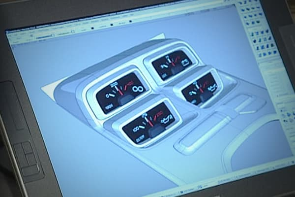The four-pack of gauges is a retro element that is included in the 2010 Camaro. The contemporary flair took a lot of time to design in the virtual world before getting it right. It is one of the highlights for Welburn & Dale Jr.
