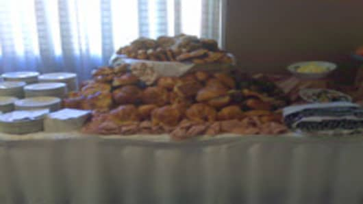 Mounds of food untouched by the crowd that wasn't.