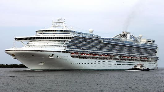 After an incident aboard the Crown Princess, the cruise ship returns to the port at Cape Canaveral, Fla. on Tuesday, July 18, 2006. The Crown Princess suddenly rolled heavily to its left Tuesday, throwin