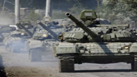 A column of Russian tanks rolls near the town of Dzhava in the separatist Georgian province of South Ossetia.