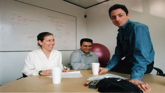 Susan Wojcicki, Omid Kordestani, and Sergey in the office in Palo Alto.