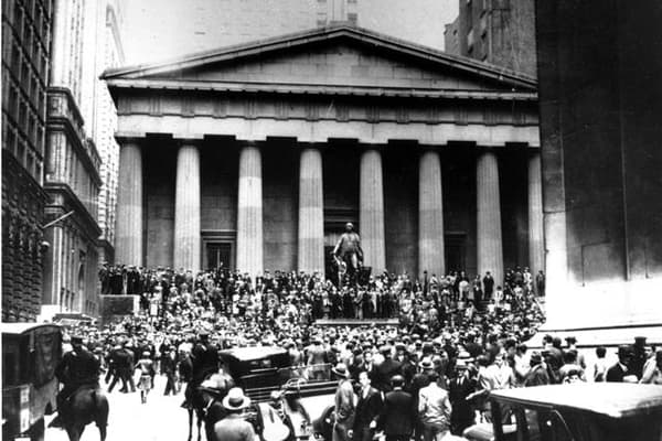 Crowds panic in the Wall Street district of Manhattan due to the heavy trading on the stock market in New York City on Oct. 24, 1929. (AP Photo)