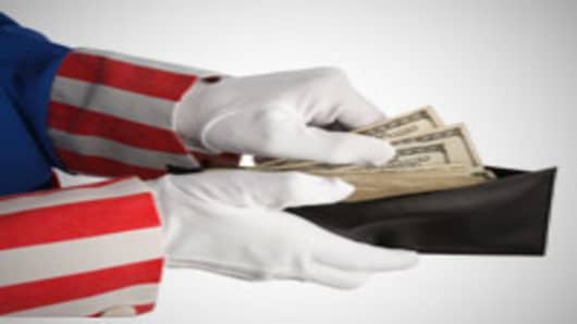 Uncle Sam taking money out of your wallet