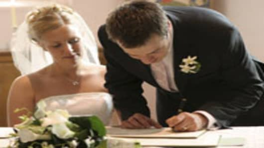 married_couple_signing_200x150.jpg