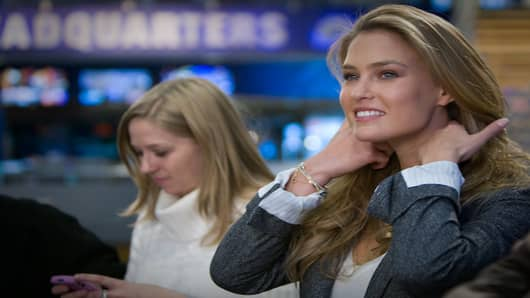 Sports Illustrated cover model Bar Refaeli readies herself before her on-air interview with Darren Rovell.