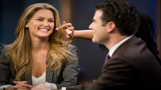 Sports Illustrated cover model Bar Refaeli on set with Darren Rovell.