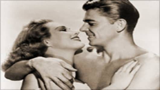 "Virginia Mayo and Ronald Reagan in the 1949 film ""The Girl From Jones Beach."""