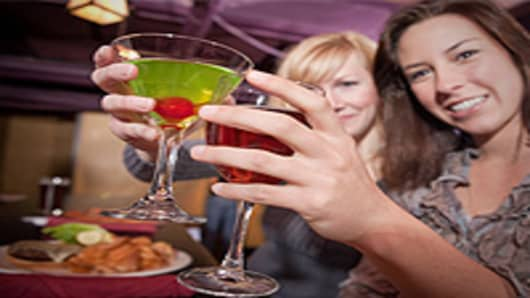 Women drinking cocktails at a club.