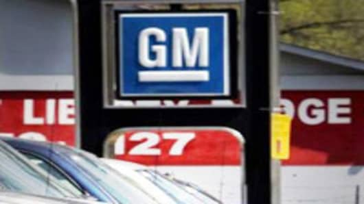GM auto dealership with sign.