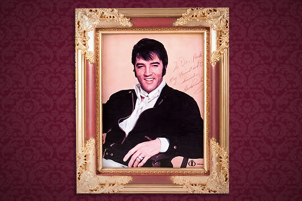 "Estimated Auction Value: $2,000 – 4,000Color photograph inscribed to Dr. Nick by Elvis, ""To Dr. Nick, My friend and Doctor. Sincerely, Elvis Presley."" This photograph was the cover of a menu used at the Hilton in Las Vegas and was displayed in Dr. Nick's professional office. A copy of ""Dr. Nick's™ Memories of Elvis"" DVD accompanies this lot. In it, Dr. Nick discusses this item and the other items owned by him in this sale.13 1?2 by 11 inches, framed"