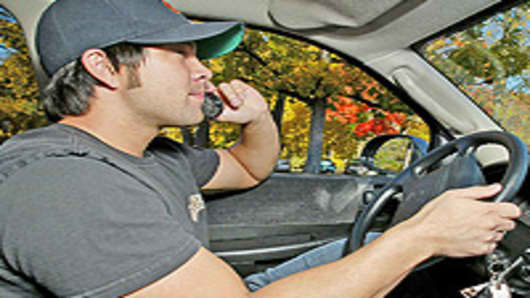 Driving while using a cellular phone.