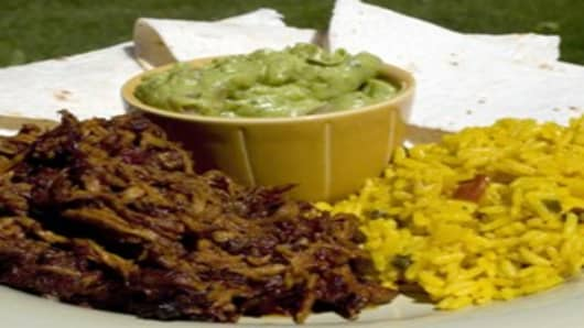 Canamelar Style Baked Pork served with rice, guacamole and tortillas, Mexico
