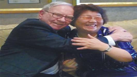 "China Daily ran this photograph with the caption: ""Warren Buffett, widely acknowledged as the 'Oracle of Omaha' embraces Li Guilian, chairwoman of Dayan Trands, a sign of the friendship and respect he developed for one of China's leading businesswomen."""