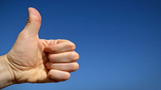 Thumbs up sign with left hand