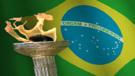 Olympic torch over Brazil flag