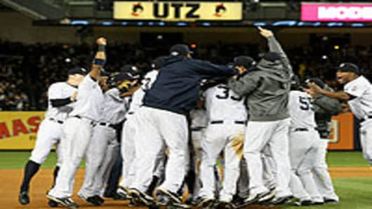 New York Yankee celebrating after winning Game 6 of the ALCS against the Los Angeles Angels of Anaheim.