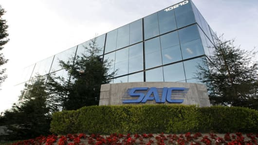 The SAIC offices in San Diego, Calif., are shown Tuesday, Dec. 12, 2006. SAIC Inc., announced earnings for the third quarter had grown 8 percent or 28 cents per share to $98,000,000. (AP Photo/Lenny Ignelzi)