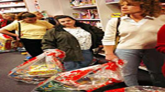 Customers wait in line to pay for their items on Black Friday at KB Toys in King of Prussia, Pennsylvania.