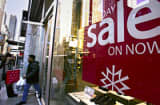 Shoppers leave a store on &#039;Black Friday&#039; in New York City.