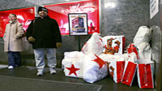 Shoppers stand with their bags at Macy's on 'Black Friday' in New York City.