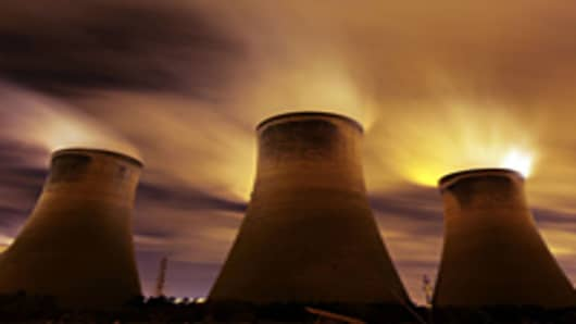 The coal fueled Fiddlers Ferry power station emits vapour into the night sky on November 16, 2009 in Warrington, United Kingdom.