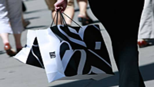 A shopper carries Saks Fifth Avenue bags up Fifth Avenue in New York City.