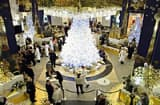 Shoppers stop to look at the newly decorated Christmas floor at KADEWE department store in Berlin, Germany.