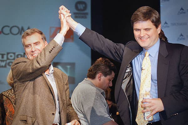 In January 2000, ubiquitous Internet service provider AOL moved aggressively into content creation by agreeing to buy Time Warner for a staggering $164 billion. It was the largest corporate deal ever, engineered by Time Warner chief executive Gerry Levin (left) and AOL boss Steve Case. Wall Street had already seen a flood of dot-com businesses looking to go public in the late 90s, and when they did issue IPOs, the staggering market capitalizations made some nebulous companies, like TheGlobe.com,