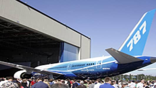 The Boeing 787 Dreamliner is unveiled during the world premiere of this aircraft in Everett, Washington.