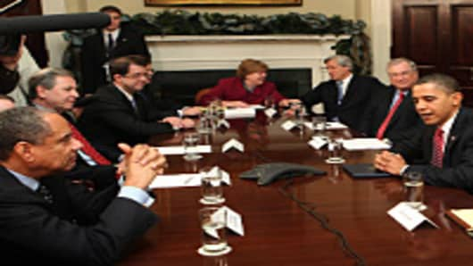 President Barack Obama, Treasury Secretary Timothy Geithner, and Chair of the Council of Economic Advisors Christina Romer meet with CEO of PNC Jim Rohr, CEO of JPMorgan Chase Jamie Dimon, and other members of the financial services industry at the White House on December 14, 2009.