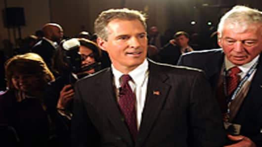 Republican State Sen. Scott Brown exits the debate hall following a senatorial debate at the University of Massachusetts January 11, 2010 in Boston.