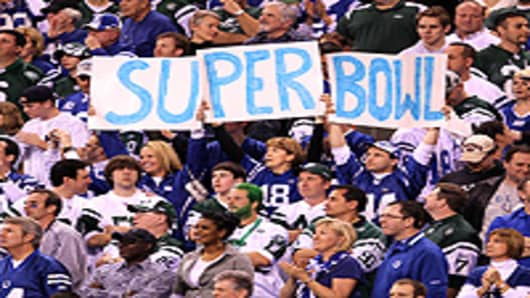 Fans of the Indianapolis Colts hold up a 'Super Bowl' sign in the fourth quarter as the Colts took on the New York Jets during the AFC Championship Game.