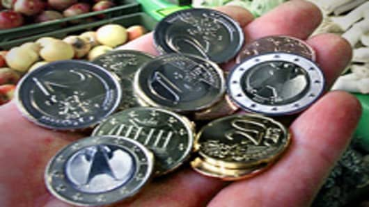 Euro coins in hand