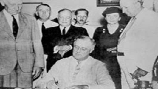 President Franklin D. Roosevelt, signing the original Social Security Act on August 14, 1935.