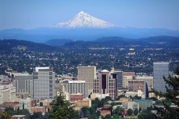 "Another major city, Portland is attractive to retirees because of its small town, at times bohemian feel. AARP Magazine describes the lifestyle as ""European charm meets environmental nirvana,"" which offers miles of bike lanes, world-class art museums, waterfront parks and diverse shopping in the city's Pearl District. Residents enjoy pedestrian access to many attractions in the city and a light rail system called the ""MAX"" that connects the city and suburbs. The city's blocks are small in length"