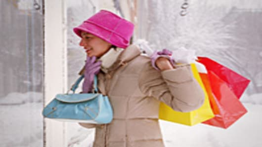 Woman window shopping on a snowy street
