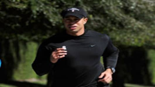 Tiger Woods jogs near his home.