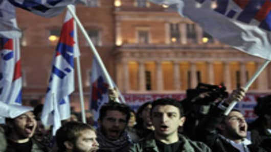 Demonstrators shout slogans against government's recent austerity economy measures during a protest in Athens.