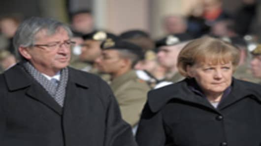 Luxembourgian Prime Minister Jean-Claude Juncker and German Chancellor Angela Merkel.